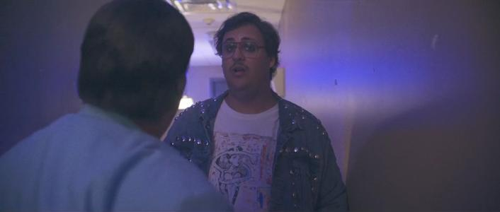 Electric Jesus Movie Scene With Bass Player Wearing Shaded Pain T-Shirt